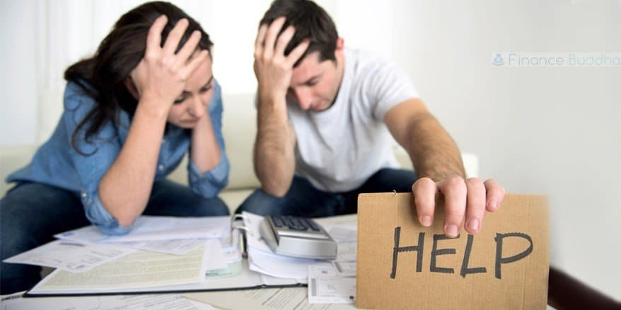 A young couple going through mail looking for IRS Back Tax Relief